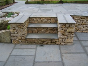 Random-limestone-walling-and-steps-with-silver-grey-Indian-stone