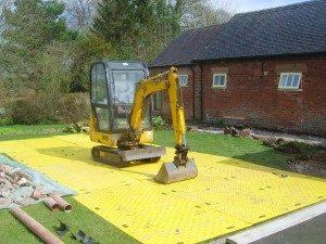 track-mats-to-minimize-lawn-damage-300x225